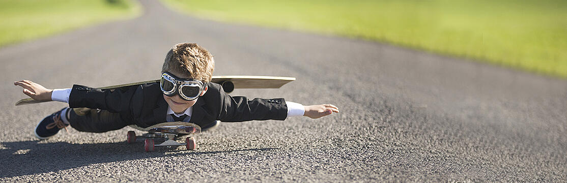 Child laying down on skateboard